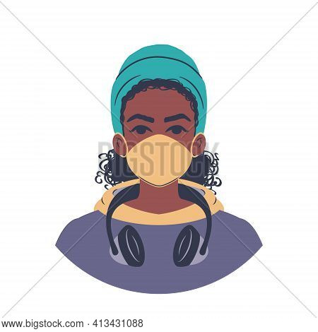 Portrait Of A Young African Woman In A Colorful Hoodie Wearing A Beanie, Headphones And A Face Mask.