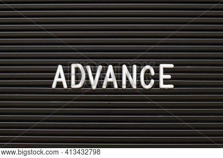 White Alphabet In Word Advance On Black Color Felt Letter Board Background