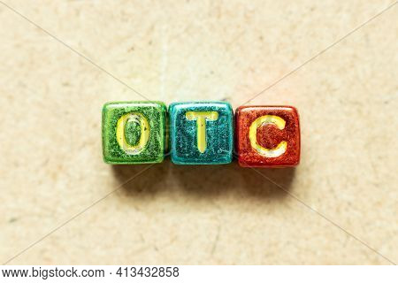 Metallic Color Alphabet Letter Block In Word Otc (abbreviation Of Over The Counter)  On Wood Backgro