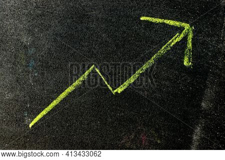 Green Color Chalk Handdrawing As Upward Arrow Graph On Blackboard Or Chalkboard Background (concept