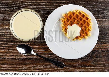 Transparent Bowl With Condensed Milk, Biscuit Waffle Poured Condensed Milk In White Plate, Teaspoon