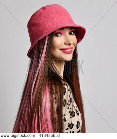 Happy Smiling Wealthy Woman With Colored Strands In Stylish Pink Bucket Hat And Leopard Pullover Sta