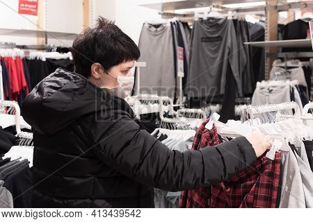 Young Girl In The Store Chooses Clothes, Knitwear