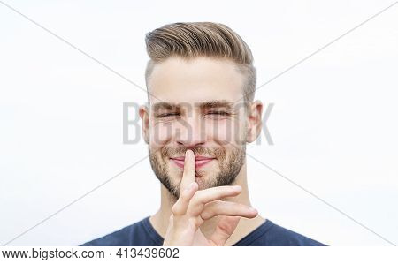 Serious Man With Finger On Lips. Conspiracy, Shh. Isolated Attractive Man Shows Silence Sign