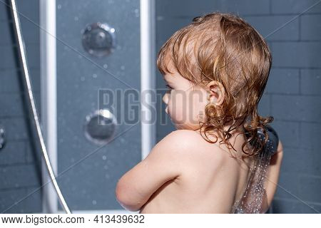 Toddler In A Bathtub. Washing Adorable Baby In Bathroom. Kid With Soap Suds On Hair Taking Bath. Clo