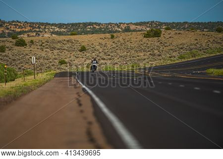 Panoramic Picture Of A Scenic Road With Biker On Motorbike. American Motorcycle Tour Journey. Travel