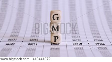 Gmp Word Written On Wood Block On Chart Background .
