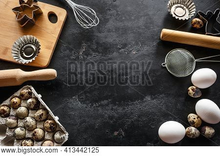 Ingredients And Utensils For Baking On Black Background With Place For Text