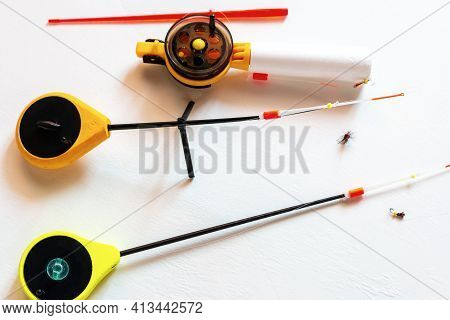 Different Winter Fishing Rods Close Up