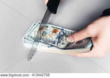 Sawing Money With A Saw On A White Background Concept Corruption