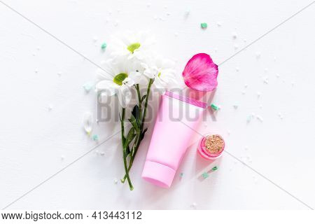 Flowers And Natural Cosmetics With Place For Text On Packaging