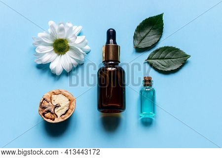 Perfume From Natural Ingredients On A Blue Background Close Up