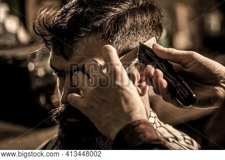 Barber Works With Hair Clipper. Hipster Client Getting Haircut. Hands Of Barber With Hair Clipper, C