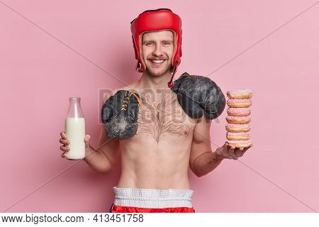 People Sport And Nutrition Concept. Positive Skinny Male Boxer Poses With Naked Torso Smiles Gladful
