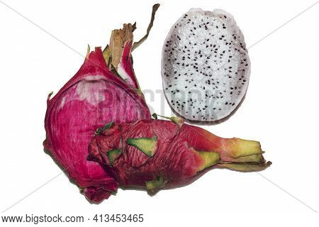 White Pitahaya Cut Into Pieces. Half Without Scaly Skin, A Whole Quarter Of Tropical Exotic Bright P