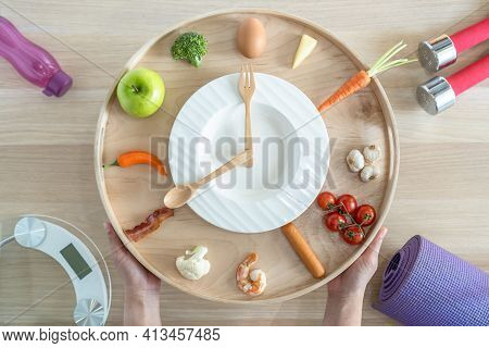 Intermittent Fasting If Diet Concept With 16:8 Hour Clock Timer For Skipping Meal And Eating Keto Lo