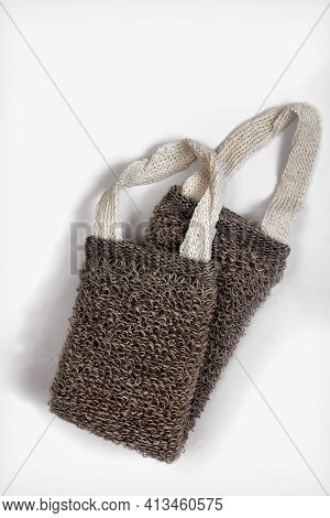 Accessories For Visiting The Bath Or Sauna: Washcloth On A White Background. Top View, Flat Position