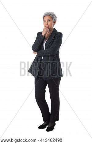 Full Length Portrait Of Mature Asian Woman Thinking Holding Chin Isolated On White Background, Busin