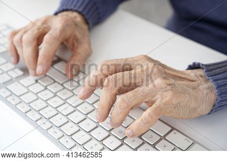 Elderly Woman Wrinkled Hands Typing On Computer Keyboard