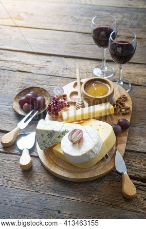 Cheese Board With Camembert Cheese, Parmesan Cheese, Maasdam Cheese. The Composition Is Complemented