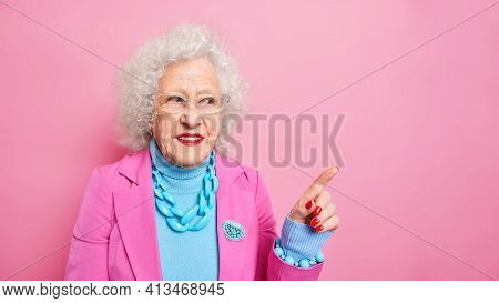 Mature Beautiful Woman With Wrinkled Skin Wears Stylish Clothes Jewelry Indicates At Upper Right Cor