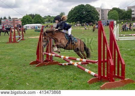 East Kilbride, South Lanarkshire, Scotland, Uk - June 14, 2014: Female Show Jumper Taking Part In Th