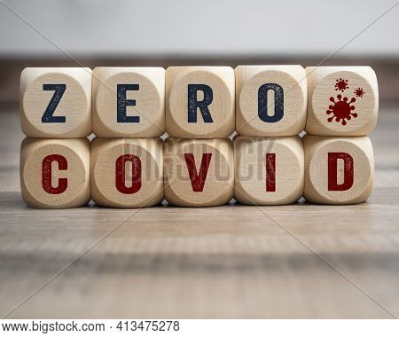 Cubes, Dice Or Blocks With Zero Covid On Wooden Background