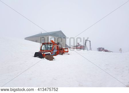 Ski Track Vehicle Buried In Snow On Top Of The Mountain, At Sinaia, 2000 Meter Altitude In Romania,