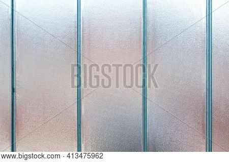Frosted Patterned Glass On A Tiled Window. Texture, Transparent, Matte White And Grey Frosted Glass,