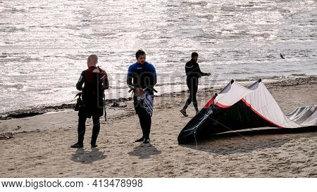 Young People Get Their Gear To Go Kiteboarding In The Gulf Of Riga On October 21, 2020 At Cape Kolka