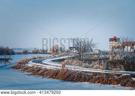 Icy Road Near The Frozen Comana Lake - Loneliness, Emptiness. Empty Icy Road Near The Frozen Lake, O