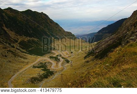 Curved Road Through High Mountains. Transfagarasan Road To Transylvania. High Altitude Vegetation Ar