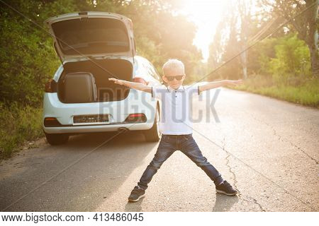 Little Boy Resting And Having Fun On The Side Of The Road On A Road Trip. Road Trip With Children Co