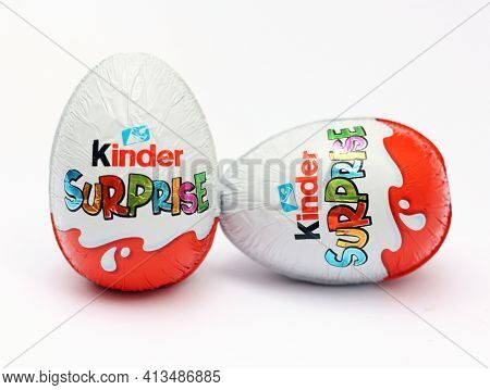Kinder Surprise Chocolate Eggs, Isolated On White Background. A Delicious Chocolate Egg, With A Funn