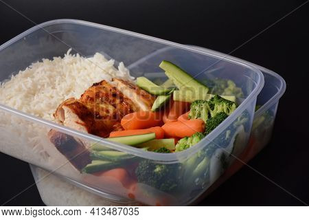 Healthy Balanced Lunch Boxes. Grilled Chicken, Carrots, Cucumbers, Broccoli, And White Rice. Lunch B