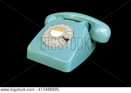 Turquoise Rotary Dial Seventies Telephone. Isolated Over Black