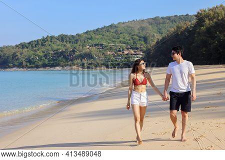 Portrait Of Beautiful Young Women And Boyfriend Asian, Wearing Rea Bikini And Stylish White Sunglass