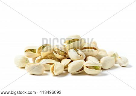 Pistachios Nuts Isolated On White Background. Healthy Nut Concept