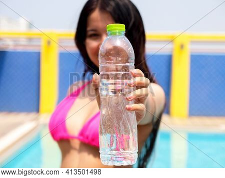 Healthy Athletic Woman Drinking Pure Water After Go Swimming To Be Fresh In The Swimming Pool. Asian