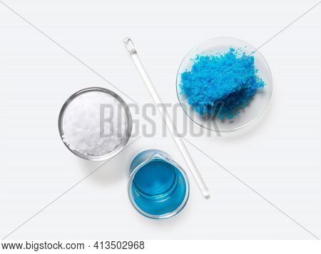 Inorganic Chemical Placed Next To The Stirring Rod On White Laboratory Table. Copper(ii) Sulfate, Mi