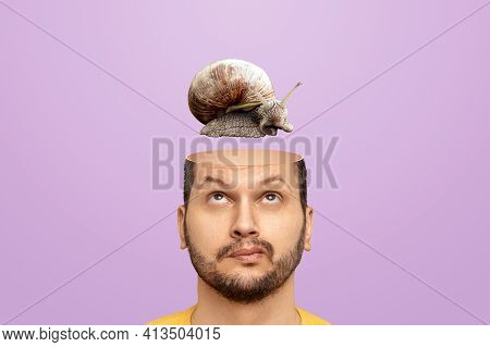Slow Brain Concept, Problems With Head Functions, Alzheimer's. A Man Has A Snail In His Head Instead