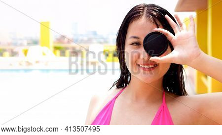 Healthy Athletic Woman Go Swimming With Camera Cover To Be Fresh In Swimming Pool. Asian Swimmer Wom