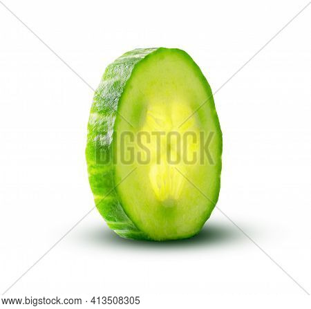 Cucumber Slice With A Magic Glow From Inside Isolated On White Background. Fresh Cut Cucumber Closeu