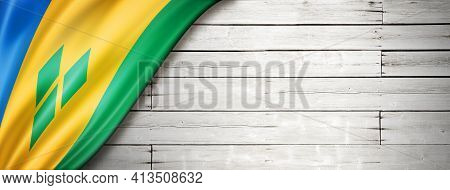 Saint Vincent And The Grenadines Flag On Old White Wall. Horizontal Panoramic Banner. 3d Illustratio