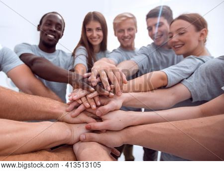 close up. international group of young people putting their hand