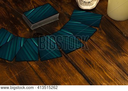 Fortune-telling Cards On A Wooden Table. Divination Concept, Tarot Cards, Psychic