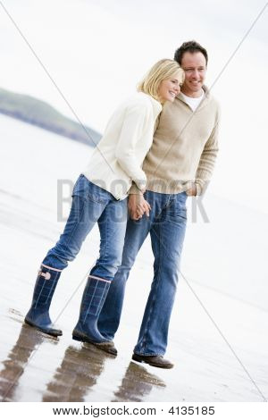 Couples Walking On Beach Holding Hands Smiling