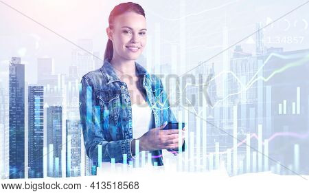 Woman In Denim Jacket, Smartphone In Hands Smiling, Double Exposure Of Office Buildings And Stock Ma