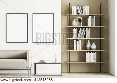 Light Modern Living Room Interior Furnished By Beige Sofa, Coffee Table, Bookshelf And Two Blank Pos