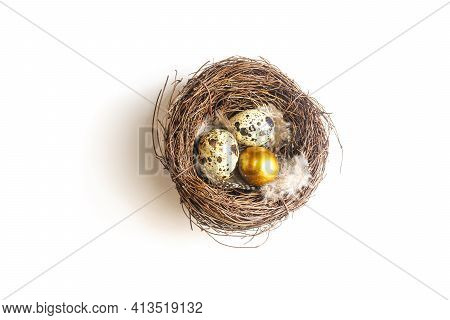 Golden Eggs In A Birds Nest On A Whight Background